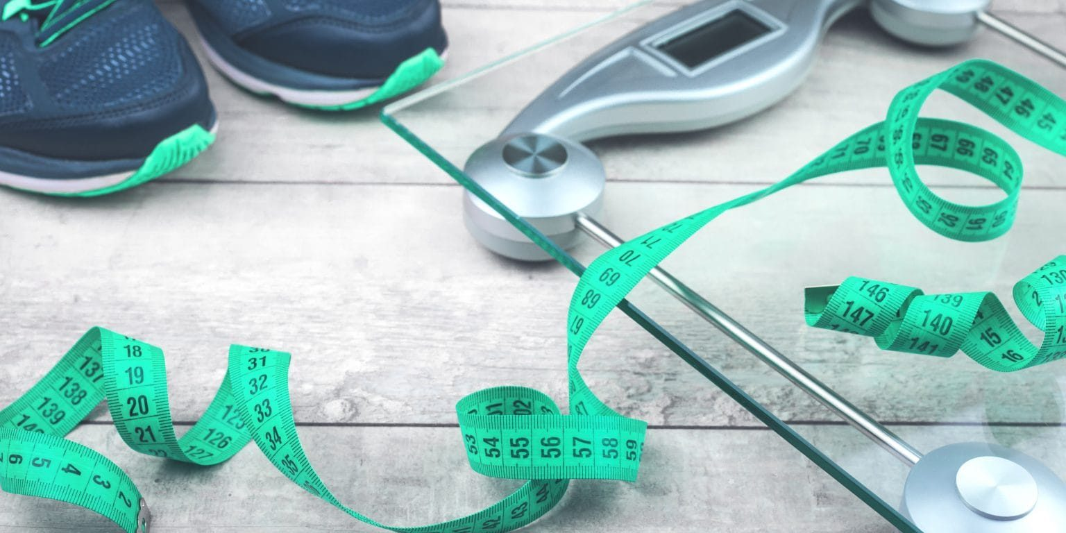 Green measure tape, glass weighing scale