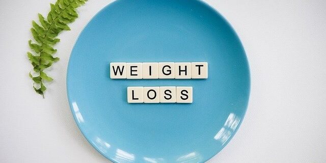 Blue plate with Weight Loss as text